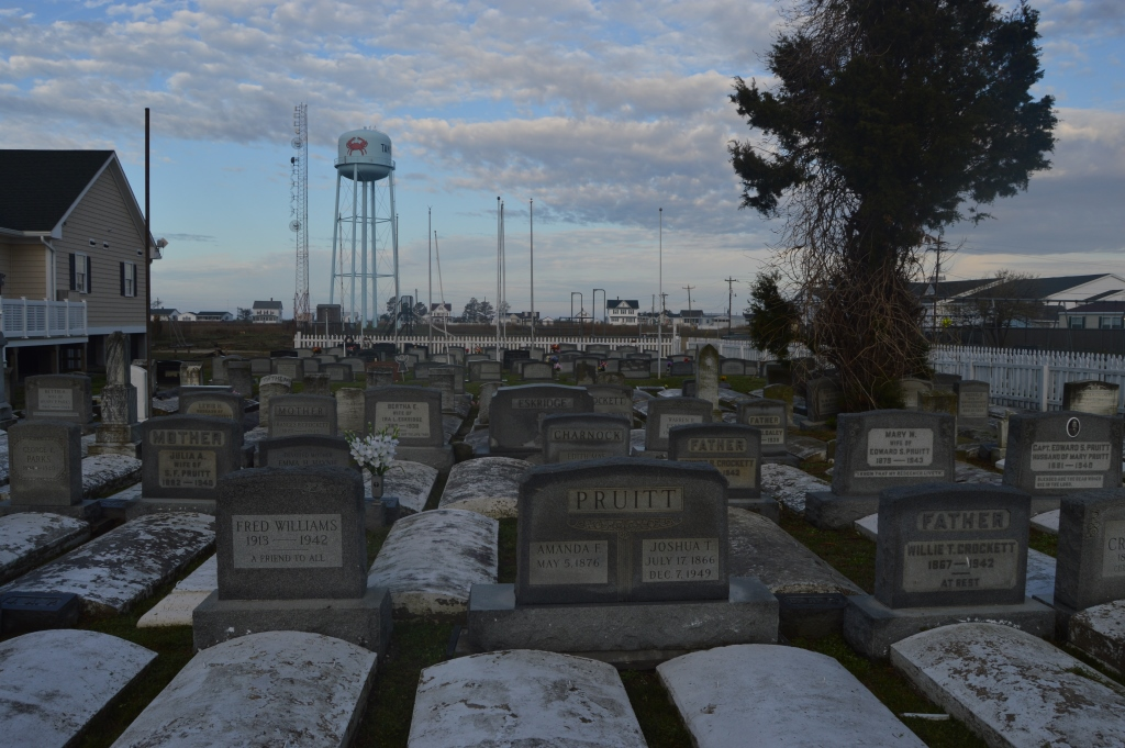 Frequent flooding requires coverings over graves on Tangier Island. Photo by Tom Pelton