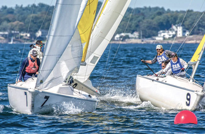 Skipper Tim Herzog shoots for the mark while defending himself off two other boats. Photo by Bruce Durkee for CYC.