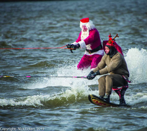 Waterskiing Santa and an elf at the Alexandria waterfront. Photo by Nick Eckert