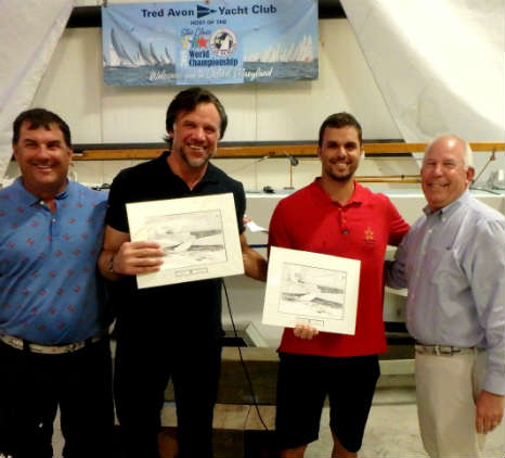 2018 Star World Champions Guilherme de Almeida and Jorge Zarif (red shirt) collect one of several daily awards at the casual crab feast on Thursday. These are custom pen and ink drawings by Marc Castelli. Photo by SpinSheet