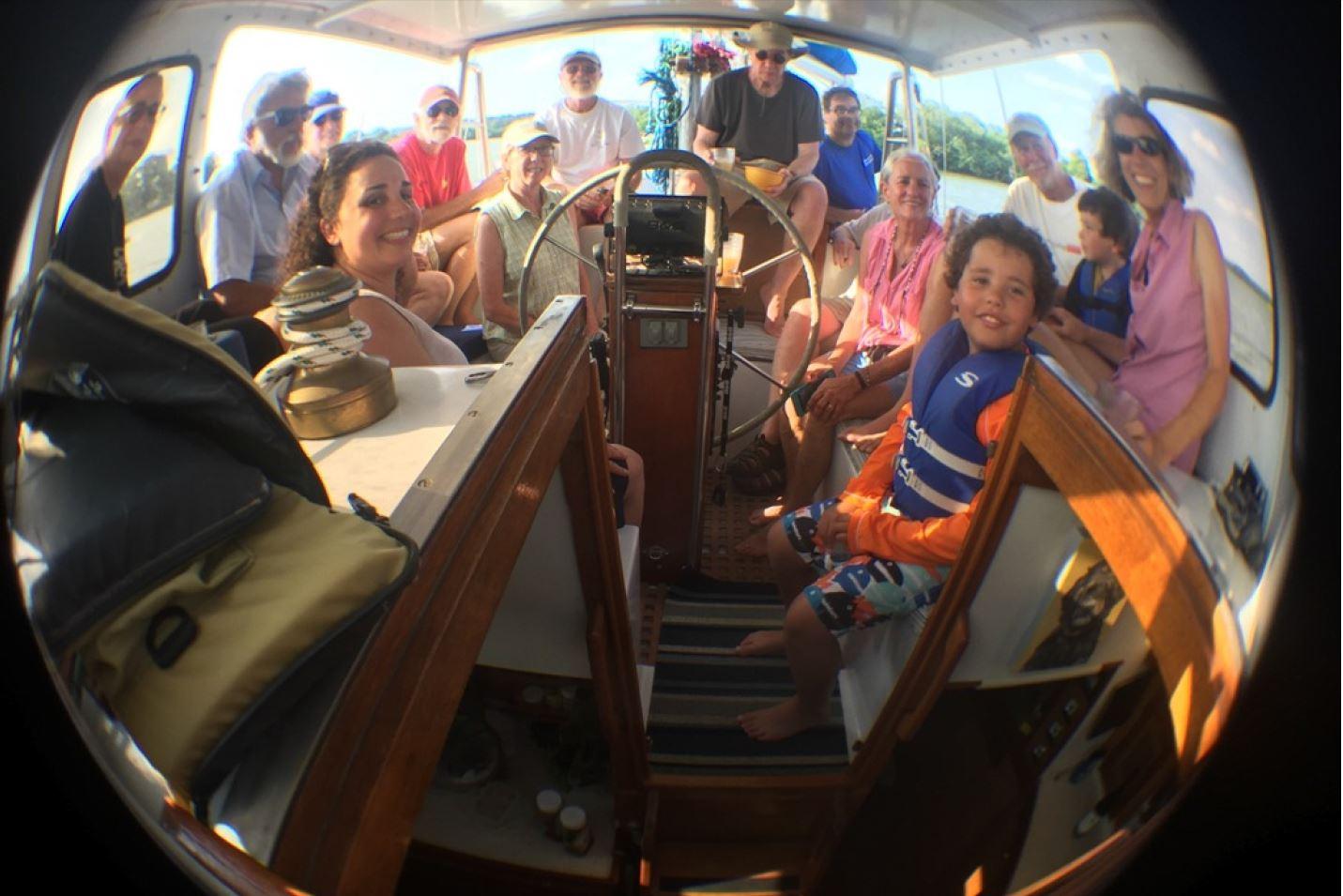 Dickerson sailors aboard Down Home through a fish-eye lens