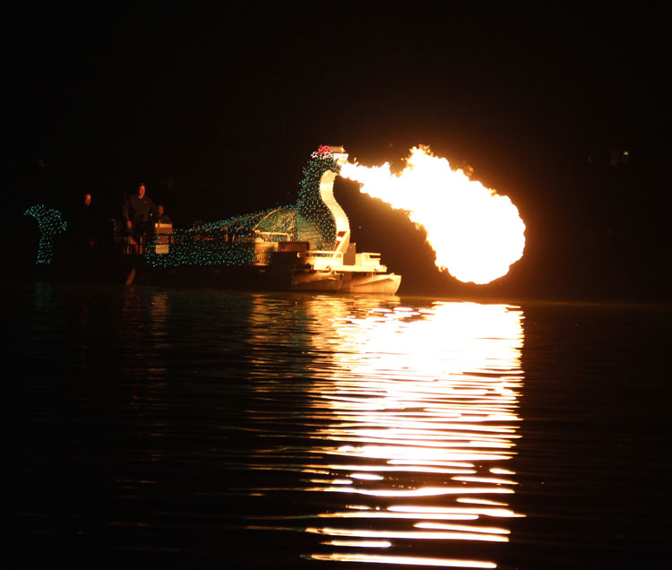 Chessie, the fire-breathing dragon of the Chesapeake, in the Middle River Lighted Boat Parade 2105.