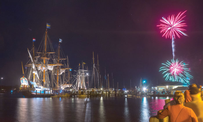 A spectacular fireworks display and illuminated ships impress spectators at Downrigging Weekend. Photo by Eric Moseson