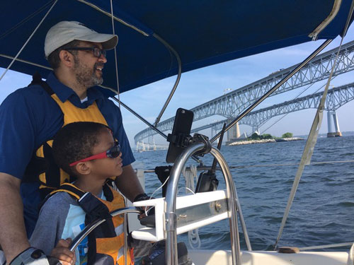 On the Cogburn's second boat, their son has his own cabin. Here he takes a turn at the helm.