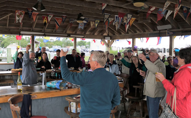 Corinthians Annapolis Fleet enjoy happy hour at the Cambridge Yacht Club