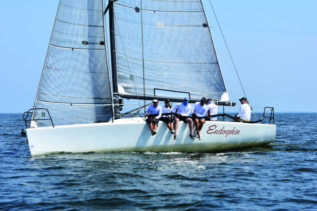 Sail trim tip: ride the inside telltales, having them just on the verge of lifting. Photo by Al Schreitmueller
