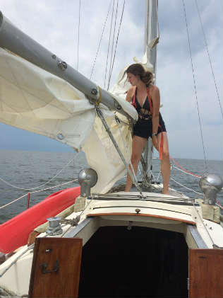 Taking the mainsail down before the storm. Photo by Shannon Hibberd