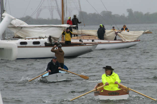 Competitors rowing to their anchored boats as in days of yore. Photo by Craig LIgibel