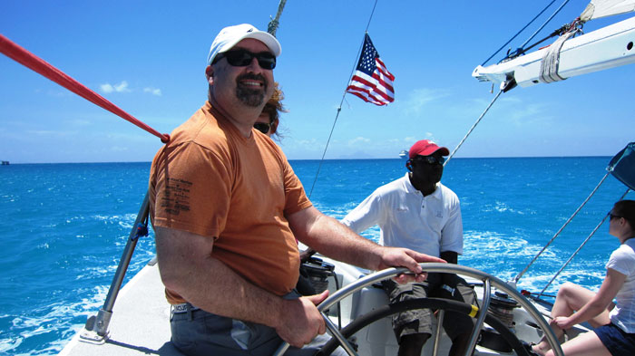 As race committee chair, Keith Jacobs has a passion for providing the best possible sailboat racing experience. Here Jacobs enjoys driving Stars and Stripes.