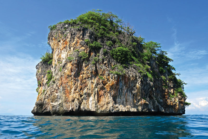 Ko Doc Mai is a typical limestone pinnacle, but this one is particularly good for diving. Photo by Michaela Urban