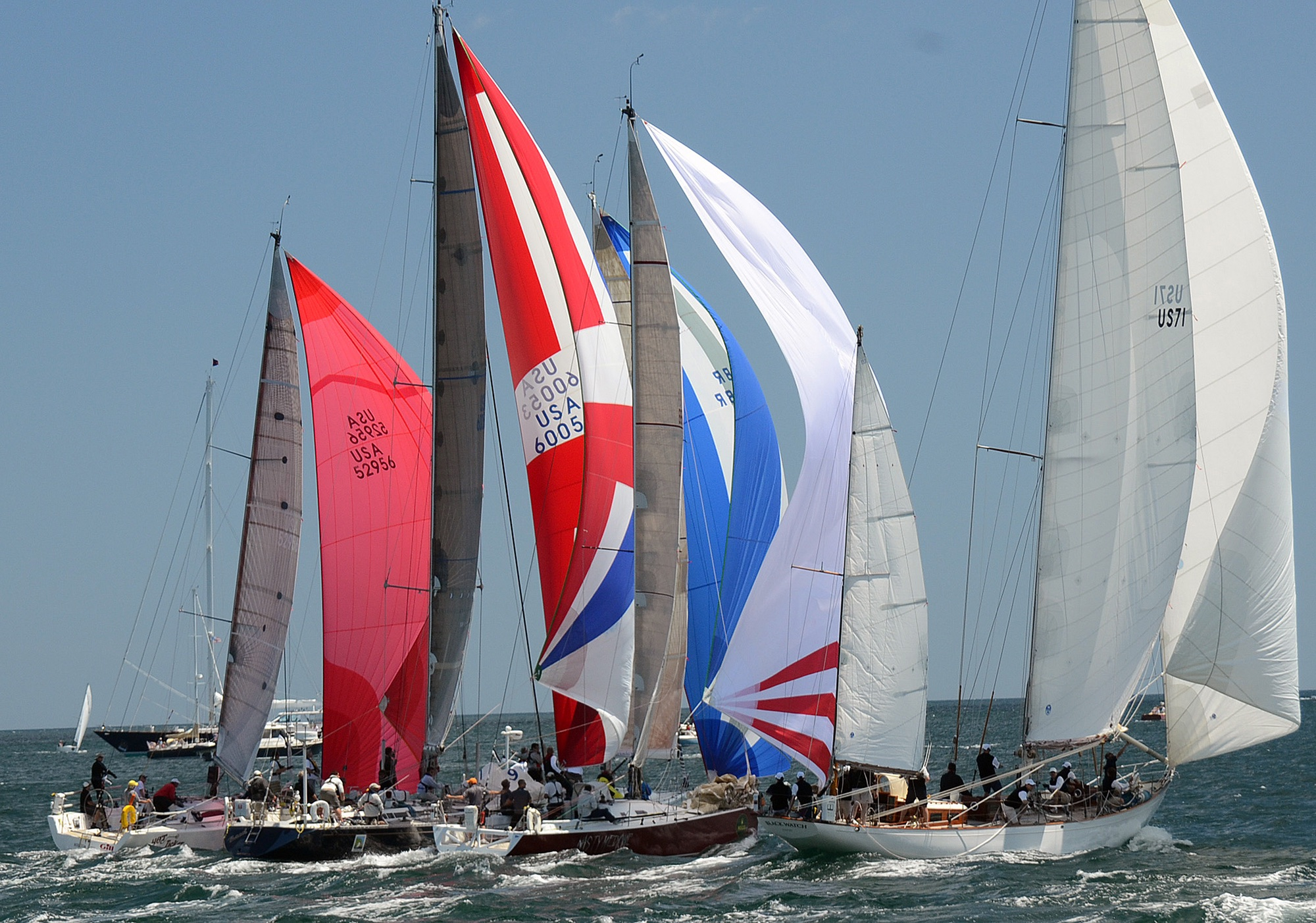 In a northerly breeze, the fleet starts under colorful spinnakers as it did in 2012 with modern boats lined up next to the white sails of Black Watch, which celebrates its 80th season with the 2108 race (Talbot Wilson photo)