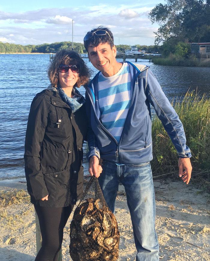 Martina Stestakova and Jordan Snyder pick up their oyster spat.