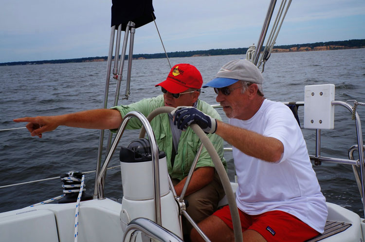 To really make progress improving your sailing skills, learn from the experts. Photo courtesy of Sail Solomons.