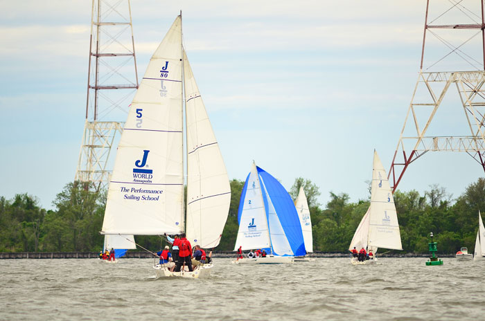To improve boathandling work with a coach who knows your kind of boat. Spinnaker class photo courtesy of J/World Annapolis.