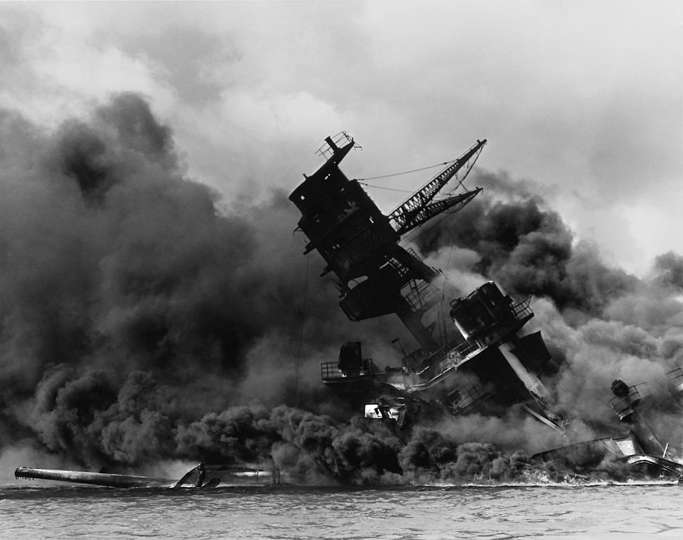The USS Arizona (BB-39) burning after the Japanese attack on Pearl Harbor, 7 December 1941. USS Arizona sunk at en:Pearl Harbor. The ship is resting on the harbor bottom. The supporting structure of the forward tripod mast has collapsed after the forward