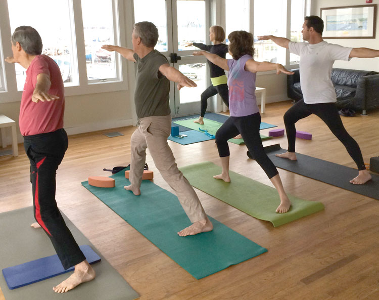 Bonnie Urban teaches yoga on Wednesday mornings at SSA. (L-R) Bill Schneider, Jim Urban, Cheryl Lecourt, Keith Carew, and Urban (front). Photo by P. Sheils