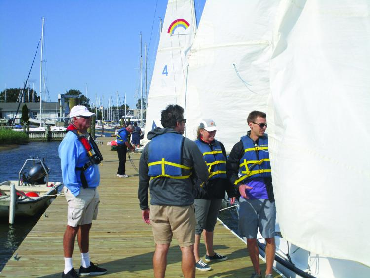 An instructor and students on the new floating docks at Annapolis Sailing School.