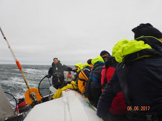 Gus Ward helms his sailboat, Crocodile, ocean sailing