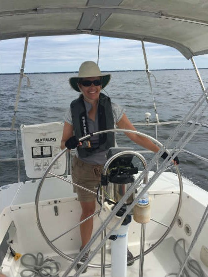 SpinSheet's own Beth Crabtree at the helm during a J/World Annapolis cruising course