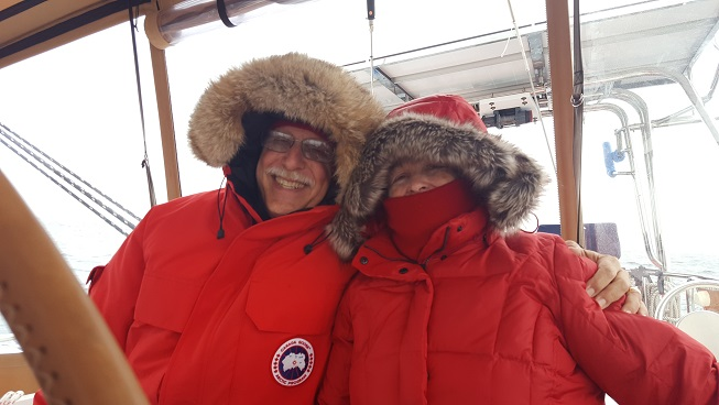The Simons celebrate crossing the Arctic Circle on their Taswell 58 Celebrate in Greenland's Disko Bay.