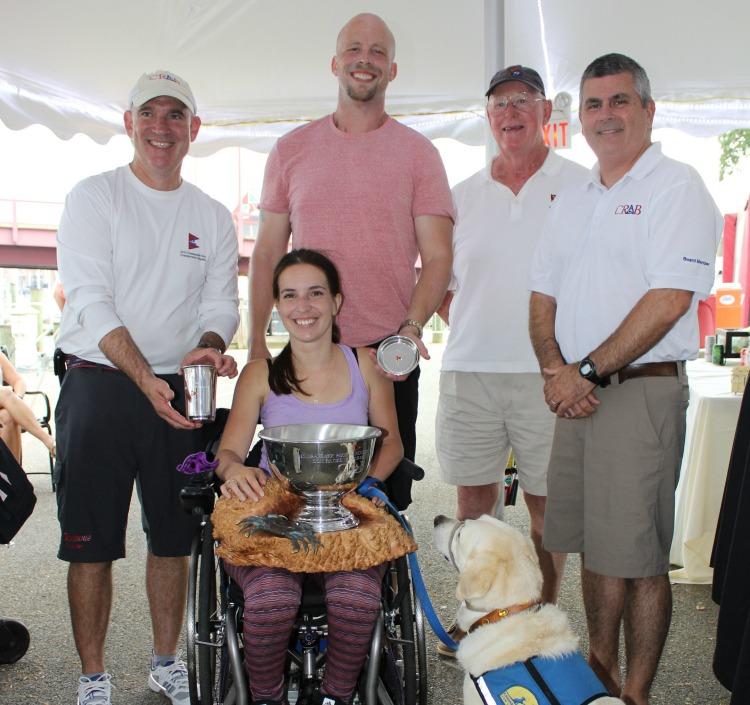 Dani Izzie (seated), Scott Gitchell, Rudy Izzie, Peter Gordon, and Brad LaTour... plus Xander the service dog.