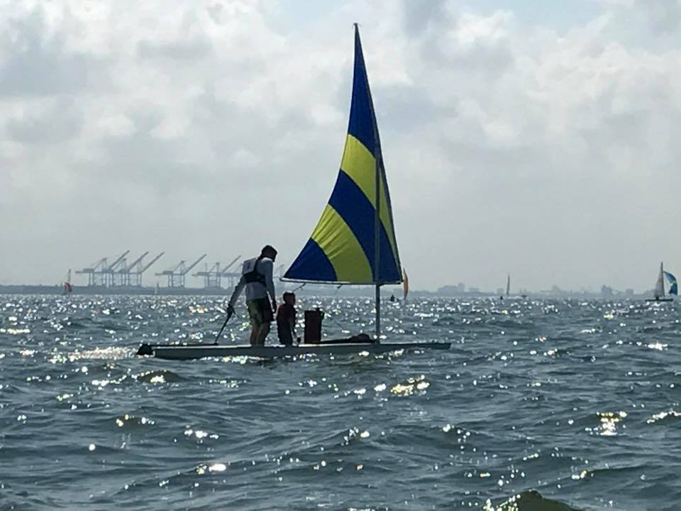 Father-son sailing.
