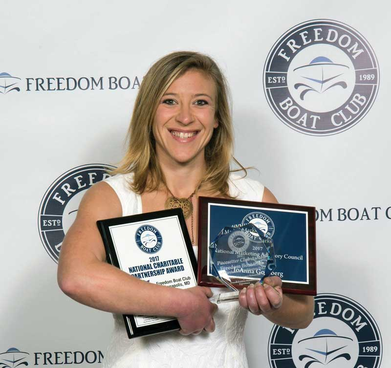 JoAnna Goldberg proudly accepts three major awards at the recent Freedom Boat Club National Franchise Conference.