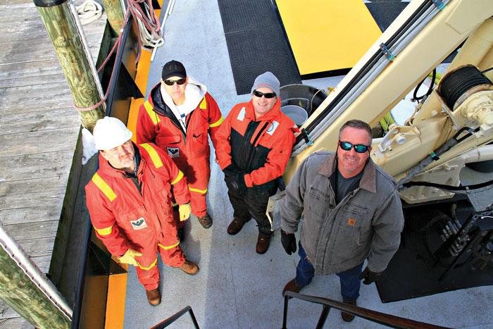 The Widener crew: chief engineer Doug Otten; Robert Heim, mate; Michael Marozza, crewmember; and captain Jeff Lill.