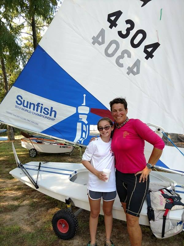 JR Futcher and a young Sunfish sailor.