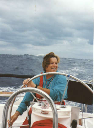 Mary Ann DeGraw at the helm off Cape Hatteras, delivering a Hunter 43 from Miami to Annapolis