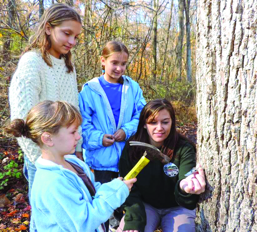 Maple sugaring is one of many water to keep kids connected to nature during winter. Photo courtesy of Oregon Ridge Nature Center.