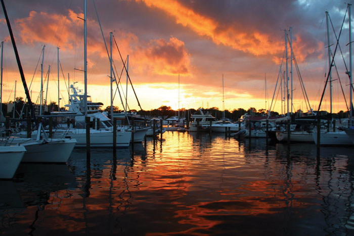 You might fall in love with the sunset view, but before you sign up for a pretty marina, make sure you talk to current slipholders about the level of customer service. Photo by Cindy Wallach