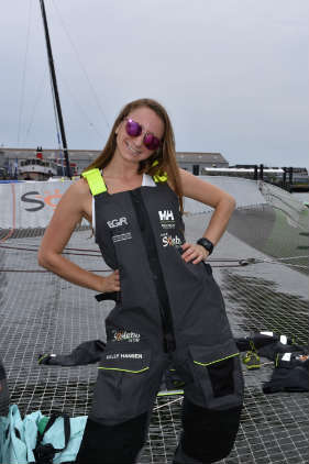 Elana tries on Coville's Helly Hansen bibs onboard Sodebo Ultim. Photo by SpinSheet