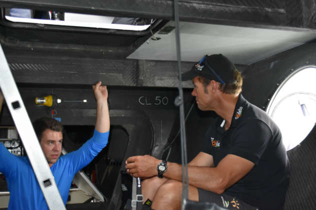 Down below on the 110-foot tri Sodebo Ultim, Brady from Helly Hansen asks Coville about life onboard. Photo by SpinSheet
