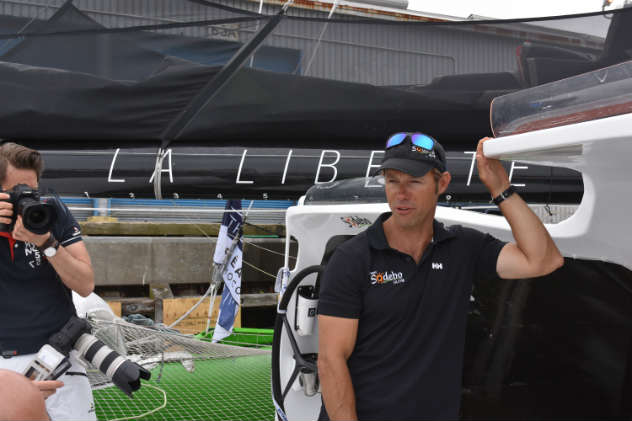 Thomas Coville aboard Sodebo Ultim, the 110-foot tri he broke the solo around-the-world record on. Photo by SpinSheet