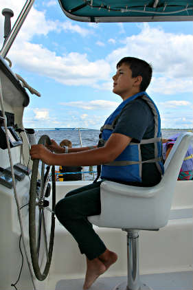 Zach at helm, cat life