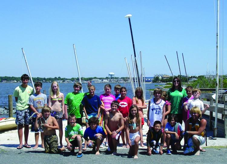 The whole crew gathers at the Rehoboth Bay Sailing Association.