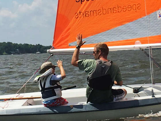 One design racing on small boats is for all age groups... high five! Photo by Dan Phelps/ SpinSheet