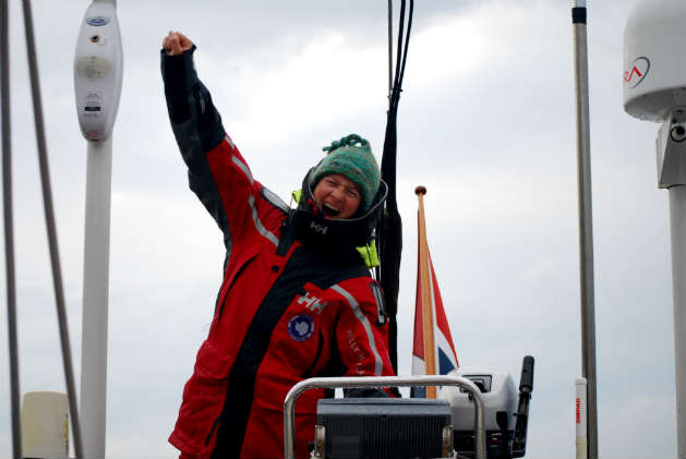 Amanda Saville at the helm of a Swan 57 having just completed a 3 year voyage from Norway to Antarctica, and return