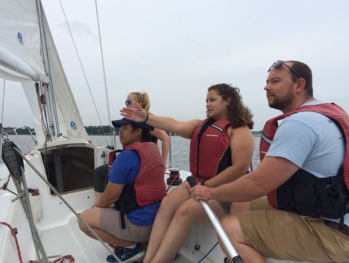 "Skipper Justin practicing man overboard recoveries, while spotter Megan keeps track of the ""man overboard"""