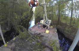 Norfolk District Operations Branch personnel use a crane barge to remove downed trees along the Dismal Swamp Canal's Lake Drummond feeder ditch here October 27,2016. The trees came down during Hurricane Matthew. Photo by Patrick Bloodgood