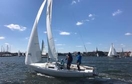 Scott Gelo, Jennifer Bickford, and Grant Beach onboard Ventus, in the hunt for hardware in the J/22 fleet