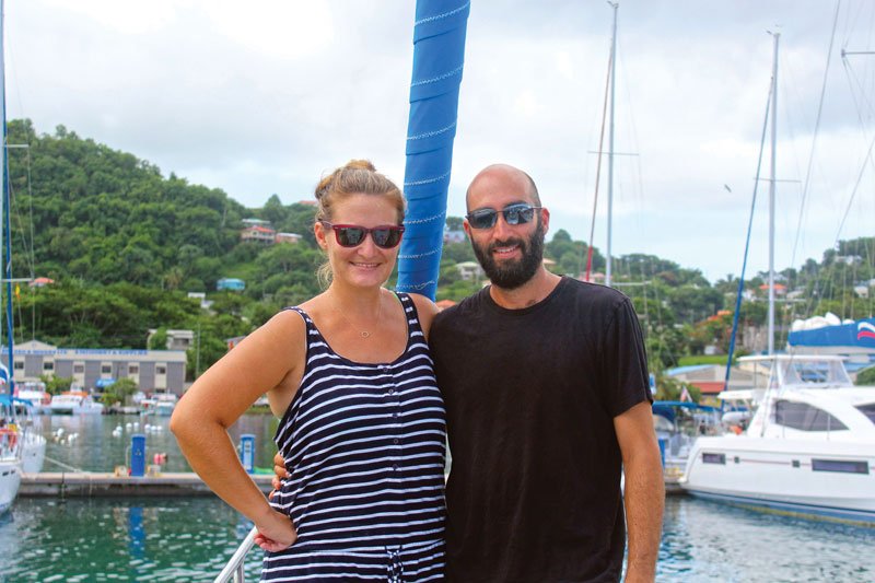 Lauren and Brian Wiesenthal on the foredeck of Nightingale Tune.