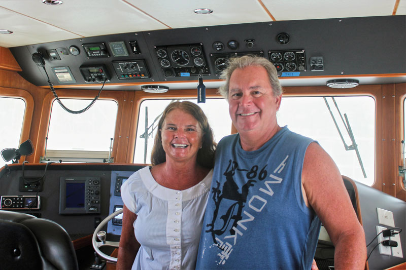 Debbie and Larry Gaddy on the bridge of Tropical Blend.
