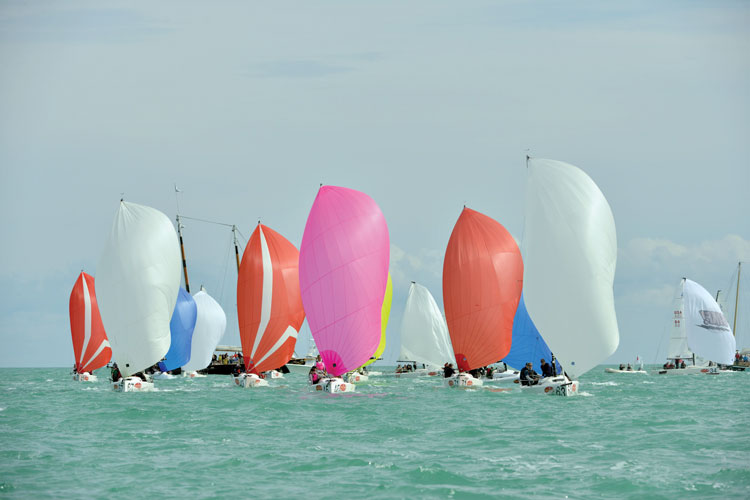 Thom Bowen's pink spinnaker at the front of the fleet. Photo by Photoboat.
