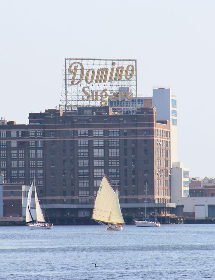 Sailing underneath the iconic Domino's Sugar plant