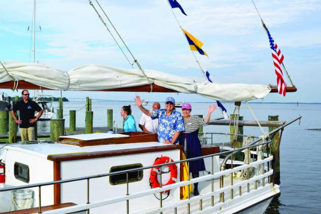 Buck Buchanan and Carol Sisco bring the skipjack home. Photos courtesy of AMM